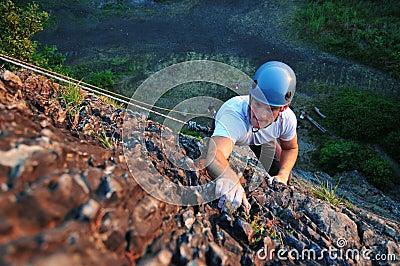 Rock climber ascending