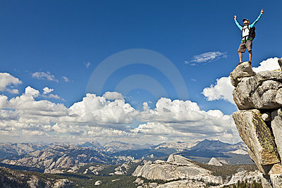 Rock Climber Celebrates On The Summit. Royalty Free Stock Photo - Image: 21980925