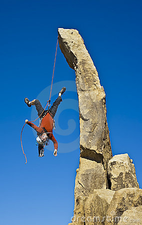 Rock climber falling upside down.