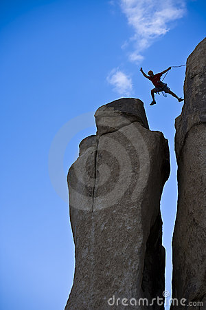 Free Rock Climber Jumping For The Summit. Royalty Free Stock Image - 6437596