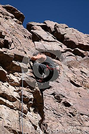 Rock climber nearing top