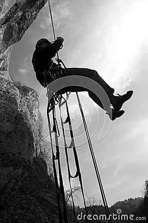 Rock climber rappeling
