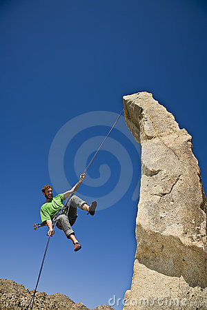 Free Rock Climber Rappelling. Royalty Free Stock Photo - 6371535