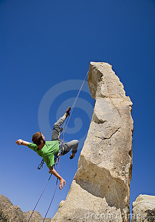 Free Rock Climber Rappelling. Stock Images - 6371554