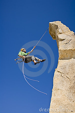 Free Rock Climber Rappelling. Stock Images - 6371604