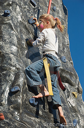 Rock climbing girl with face painting
