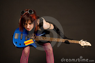 Rock girl with bass guitar