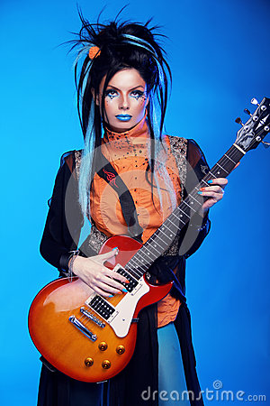 Rock girl posing with electric guitar playing hard-rock