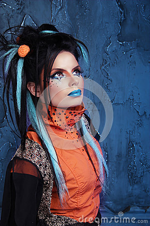 Free Rock Girl With Blue Lips And Punk Hairstyle Leaning Against Grun Stock Image - 31488791