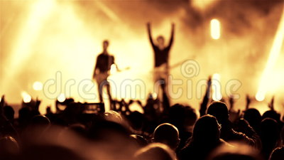 Rock guitarist band on open air live music show. Rock heavy metal band on open air live music show cheering crowd in illumination stock footage