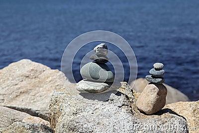 Rock stacks by blue sea
