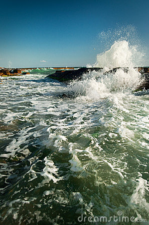 Rock and waves in the sea