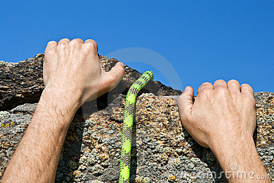 Rockclimber s hands and rope