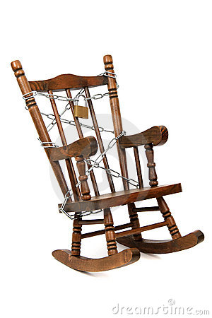 Rocking chair captured with chain and padlock