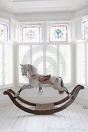 Free Rocking Horse In Bay Window Stock Photography - 33893212
