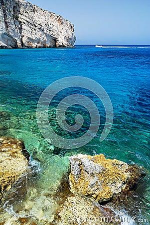 Rocks and Azure Sea