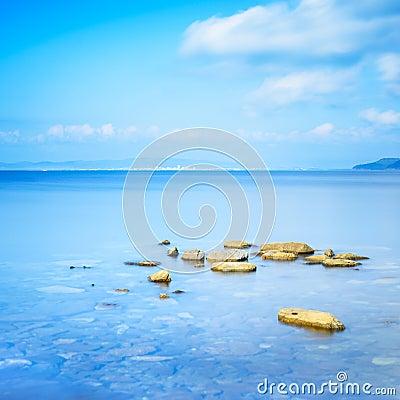Rocks in a blue ocean in a sea bay. Punta Ala, Tuscany, Italy