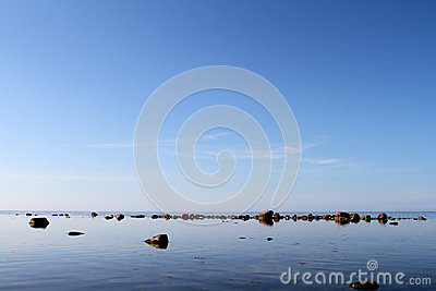 Rocks on calm waters