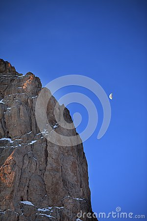 Rocks at early morning and blue sky with moon
