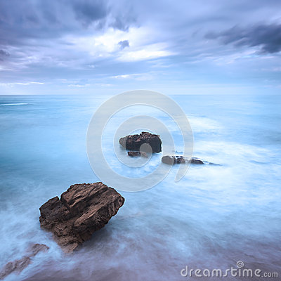 Free Rocks In A Ocean Waves Under Cloudy Sky. Bad Weather. Stock Photography - 37214582