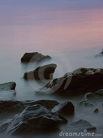 Free Rocks In The Misty Sea In Sunset Royalty Free Stock Photography - 13538937