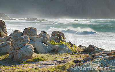Rocks, lichens ans stormy sea in Galicia Spain.
