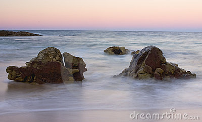 Rocks by ocean shoreline