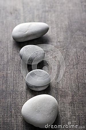 Rocks on old wooden plank