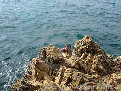 Rocks, sea and young man