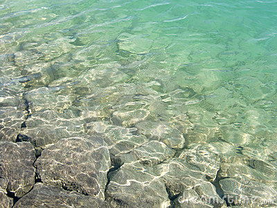 Rocks in shallow clear lake