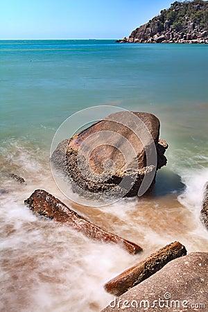 Rocks in surf on beach
