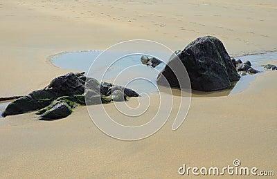 Rocks in velvet sand