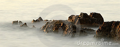 Rocks in the waves in the sunset