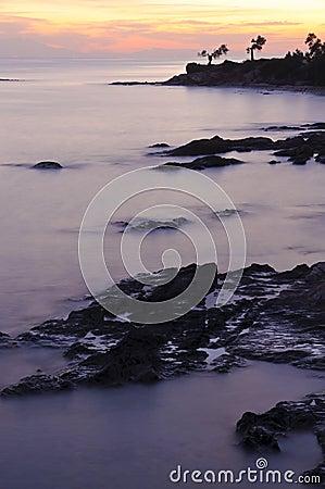 Rocky bay at sunset