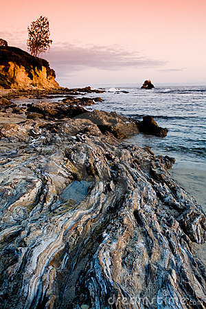 Free Rocky Beach At Sunset Royalty Free Stock Image - 700516