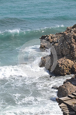 Rocky beach and waves