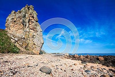 Rocky coastal scene with blue sky