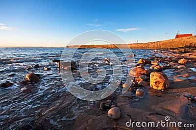Rocky coastal scene in warm sunrise light