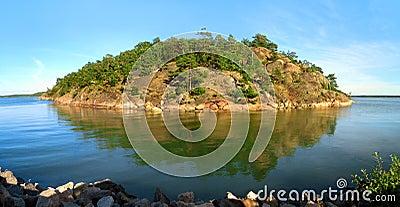 Rocky island in blue sea