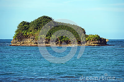 Rocky island covered by tropical vegetation