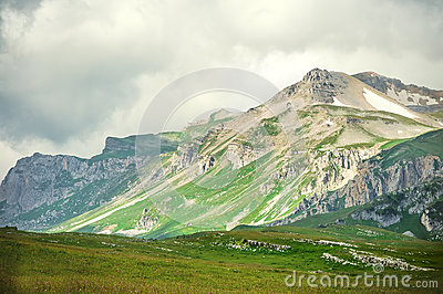 Rocky Mountains landscape with moody clouds sky
