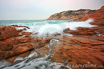 Rocky sea coast and blurred water in shek o
