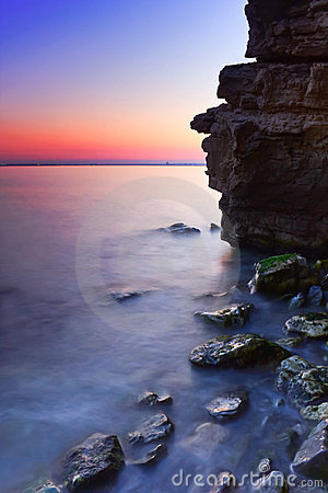 Rocky Seashore at Sunset