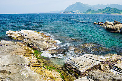 Rocky seashore and wavy ocean