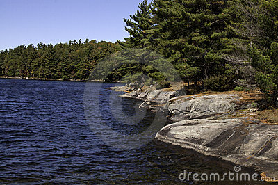 Rocky shore of lake in Muskoka, Ontario