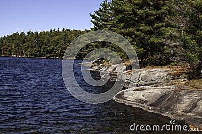 Rocky shore of lake in Muskoka, Ontario