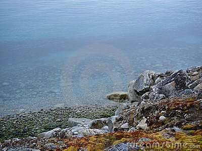 Rocky shoreline calm water