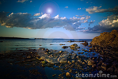 Rocky shoreline and clouds 1