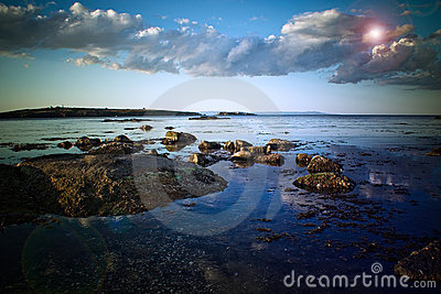 Rocky shoreline and clouds 2
