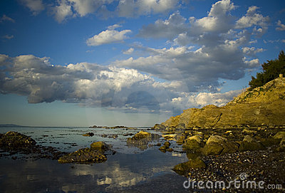 Rocky shoreline and clouds